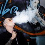 Man Smoking Vape - Exhaling Vapour