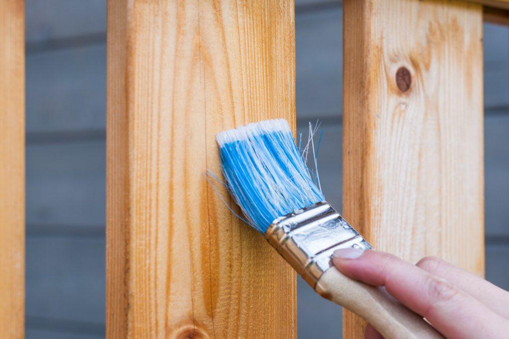 Carpentry Applying Vanish with Blue Brush