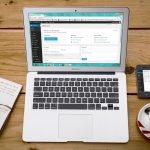 MacBook Air Laptop Viewing WordPress Website on Wooden Desk