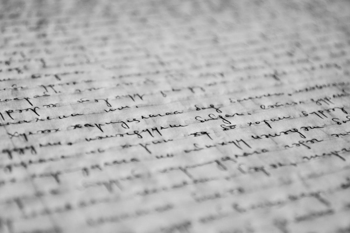 Black Hand Written Text on Gray Background Blurred